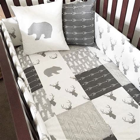 Deer Themed Crib Bedding Woodland Nursery Bedding In Gray And White With Bears Arrows And Deer For A Boy Woodland