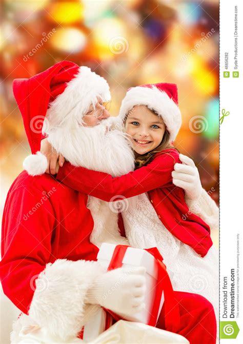 smiling  girl  santa claus stock photo image