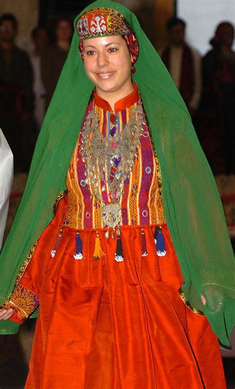 s a traditional dresses pictures file gi walks down the runway during a fashion show