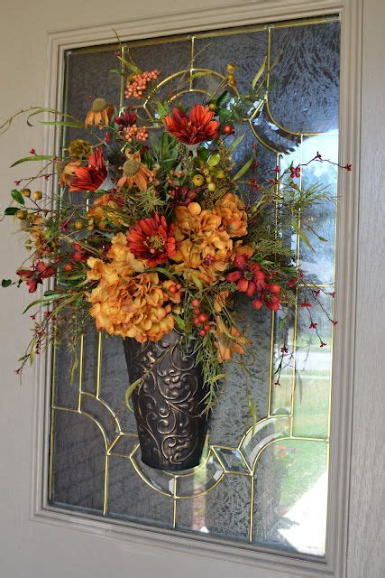 Flower Arrangement Hung On The Outside Of The Front Door Front Door Flower Arrangements