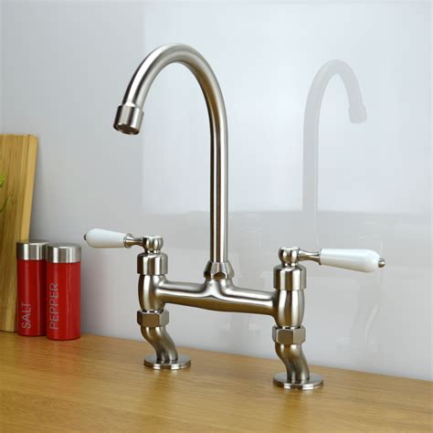 traditional white lever bridge taps kitchen sink mixer