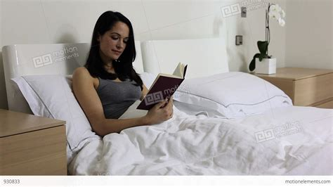 reading in bed young woman reading in bed stock video footage 930833