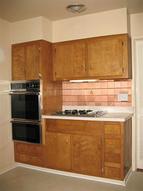 painting old wood kitchen cabinets should nancy paint her vintage wood cabinets retro