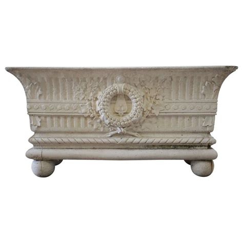 Cast Garden Planters by Beautiful Cast Garden Planter With Wreath Decoration For
