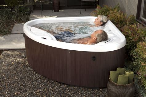 patio spa recharge with a hotspringspas compact tub