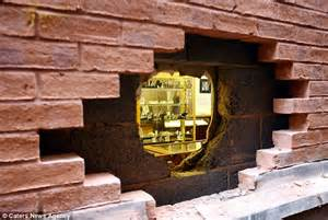 thief spends 3 hours smashing through brick wall in jw