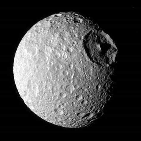 saturn moon mimas til pluto is as big as russia todayilearned