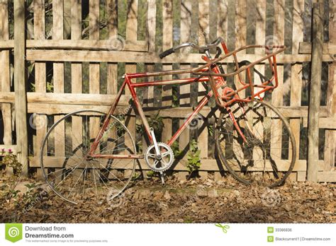old vintage images old vintage bicycle against a wooden fence royalty free