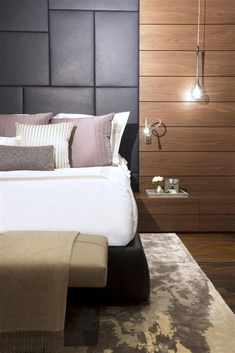 dark gray leather panels create a sumptuous headboard in