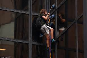 man is trying to scale trump tower on fifth avenue in nyc man is trying to scale trump tower on fifth avenue in nyc