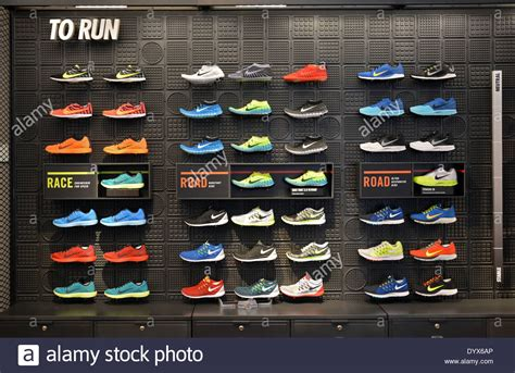 the athletic shoe shop colorful display of s running shoes at niketown