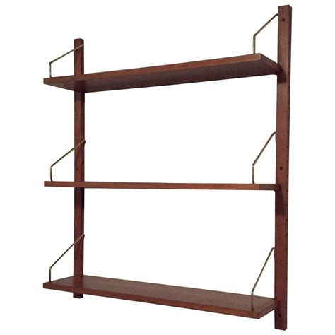 mid century solid teak adjustable three shelf wall