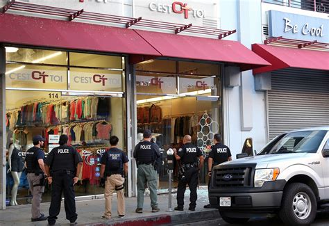 los angeles ca fashion hub raided by 1 000