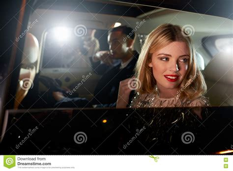 celebrity couples paparazzi celebrity couple in back of a car photographed by