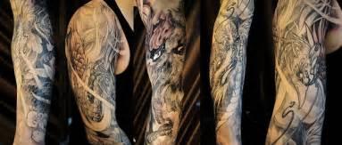 full sleeve dragon and phoenix with smoke skull tattoo
