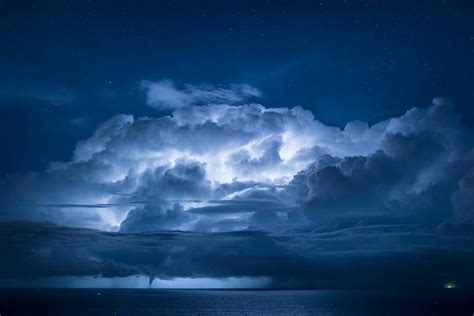 Waterspout With Lightning by Tornadic Waterspout During Strong Lightning In Italy