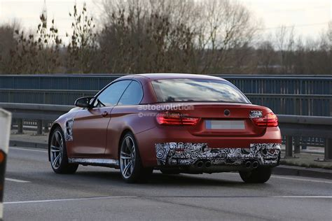 red bmw m4 spyshots bmw m4 convertible spotted with red frozen paint
