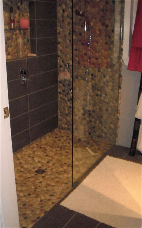 doorless curbless tile shower with river rock floor and river rock curbless shower