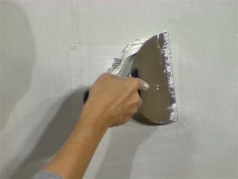 Applying Joint Compound To Ceiling by Drywall Repair Wallboard Drywall Repair Patch