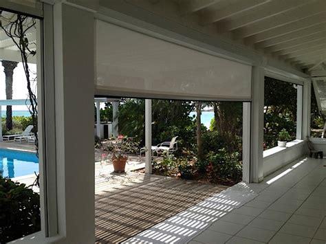 retractable patio screen motorized retractable hurricane patio screen style patio miami by fenetex
