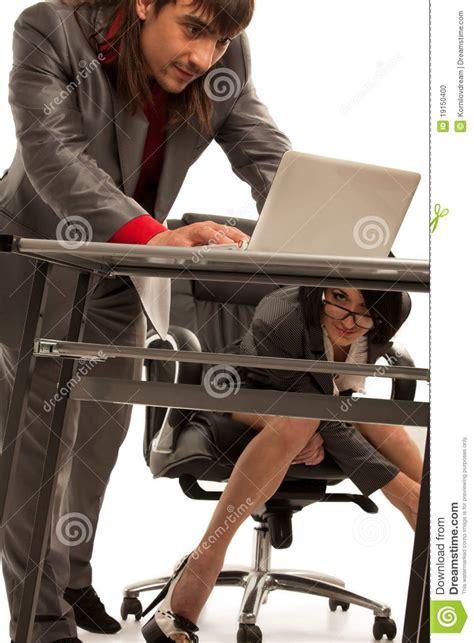 Secretaire Sous Le Bureau 1193 by Cecretary Desk Flirting With Collegue Stock Photo