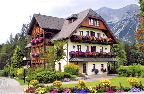 small traditional house design in tirol austria austrian alpine house in full bloom austria pinterest