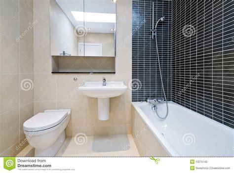 Glass Tiles For Bathroom Walls modern en suite bathroom in beige with black tiles stock