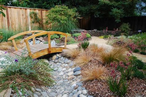 backyard bridge fill in the lacking in your garden with a bridge