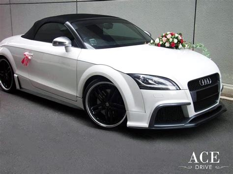 white and pink audi audi tts roadster wedding car decorations