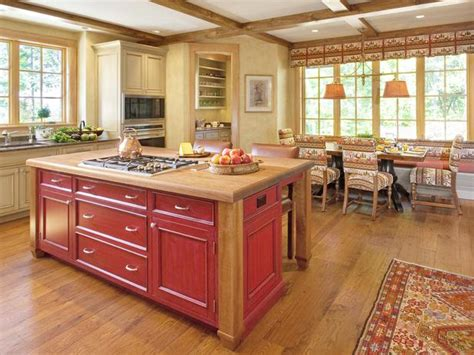 traditional kitchens with islands pale yellow country kitchen with large red island hgtv