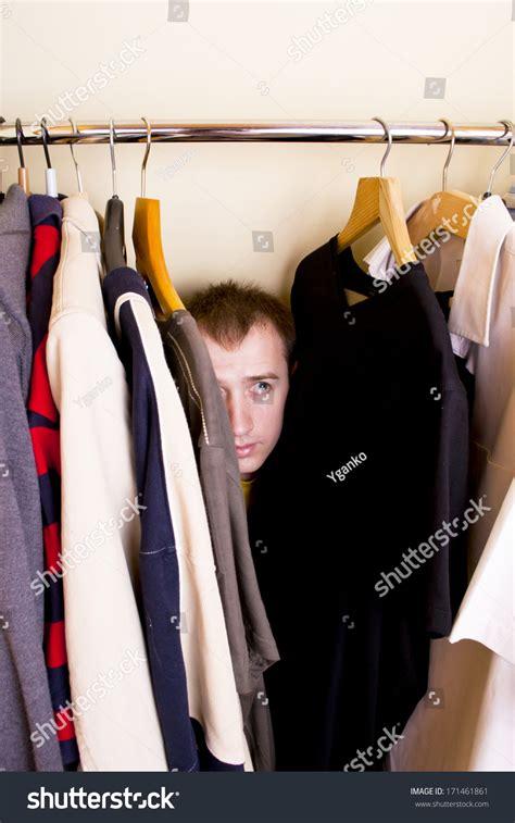 Hiding In The Closet by Hiding Closet Stock Photo 171461861