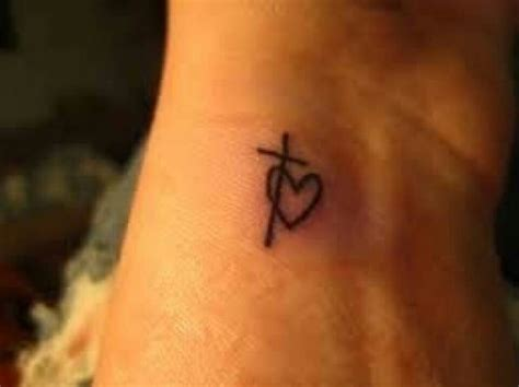 cross and heart tattoos 25 best cross tattoos ideas on