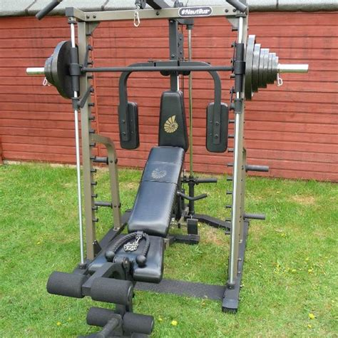 find more nautilus smith machine with 205 lbs of olympic