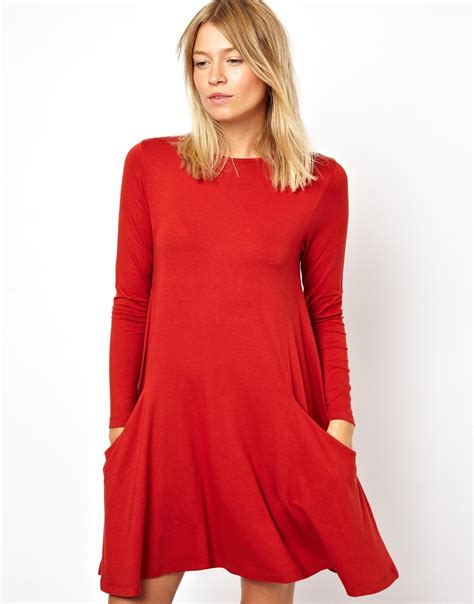 swing dress with pockets asos swing dress with pockets and long sleeves in red lyst