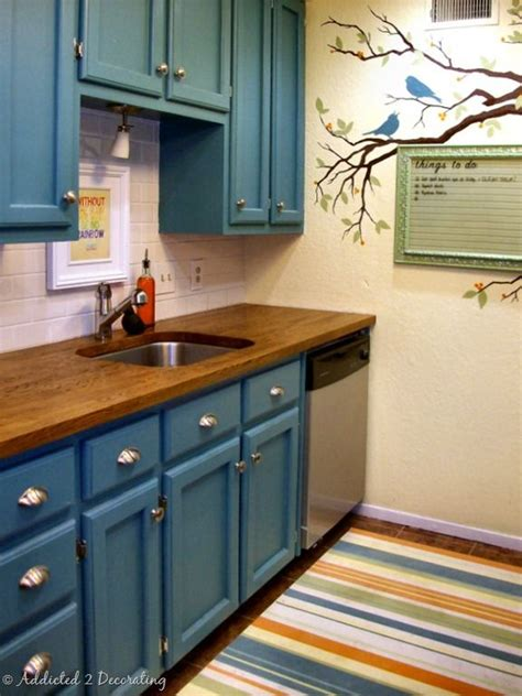 teal cabinets kitchen that s a nice twist never considered painting the cabinets
