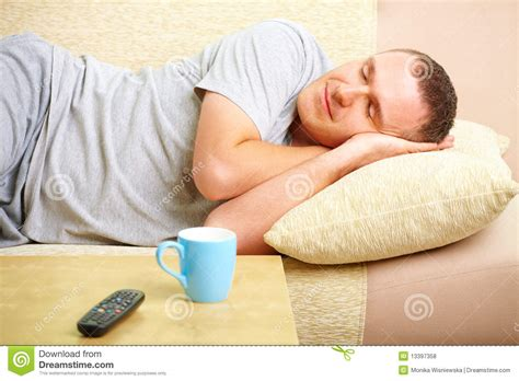 Who Sang Lay Your Upon Pillow by Relaxing On Sofa With Cup Royalty Free Stock Photos