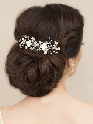 Bridal Hairstyles Low Bun With Flowers by Bridal Hairstyles Low Bun With Flowers Www Pixshark