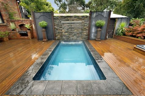 small swimming pool very small swimming pool in garden with water fountain