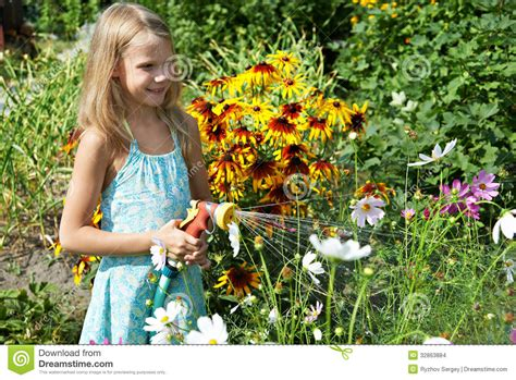 girl watering flowers little girl watering flowers stock images image 32863884