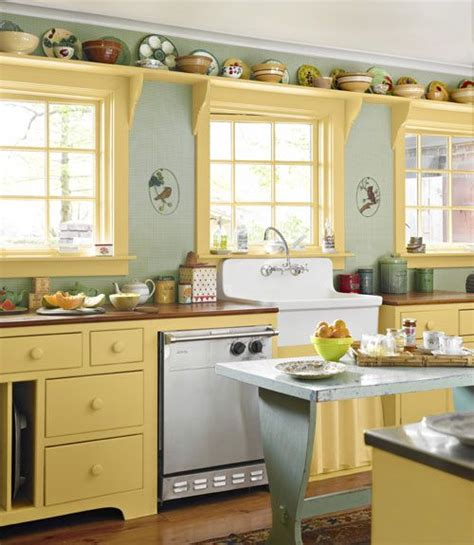 butter yellow kitchen cabinets i might do this instead of cornice boards i could have