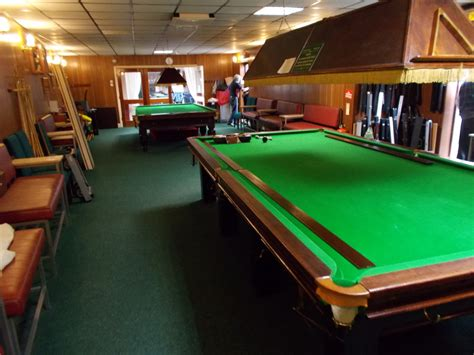 dismantle and move two size snooker tables to make
