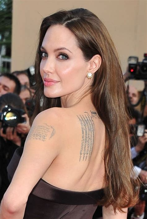 a side part with long hair and a swoop and a cross 33 angelina jolie hairstyles angelina jolie hair pictures