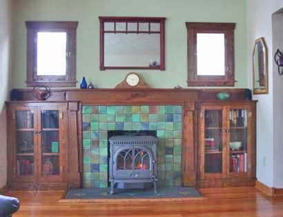1920s fireplace tiles if we put in smaller windows and put bookshelves we