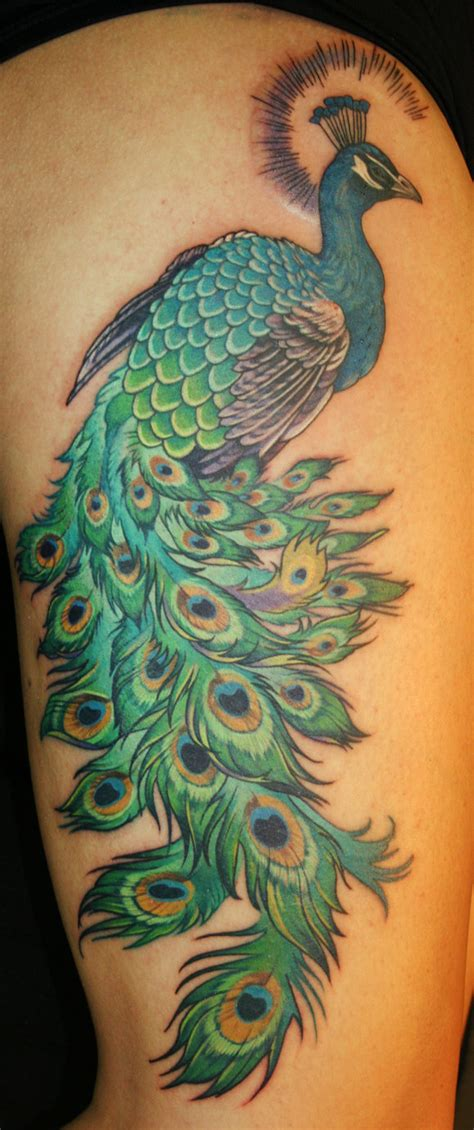 peacock thigh tattoo 7 spectacular peacock tattoos
