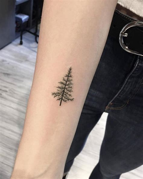 pine tree wrist tattoo tiny tattoos