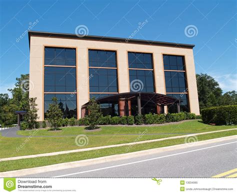 three story building three story office building with glass front royalty free