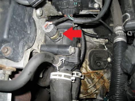 where is located engine coolant temperature ect sensor