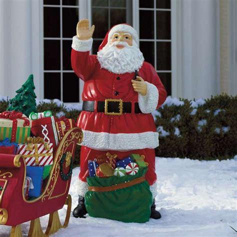 yard santa claus eraper around a tree on skis fiber optic santa with bag of toys outdoor decor toys bags and fiber