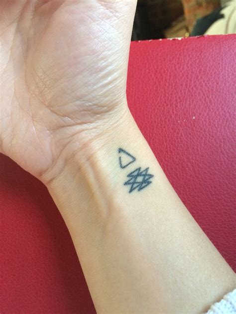 wrist girly tattoos small girly on wrist with meaning triangle symbol