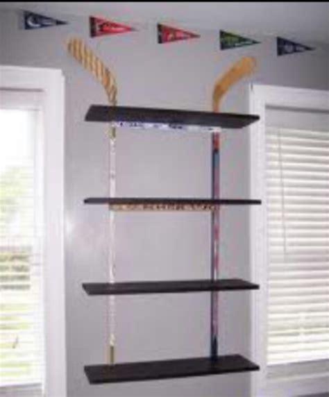 how to stick stuff to walls hockey stick wall shelf cool stuff the